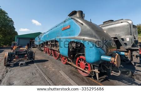 ROPLEY, UK - 19 SEPTEMBER: Vintage steam locomotive LNER 4464 Bittern at the Mid-Hants Watercress railway station of Ropley, UK on 19 Septermber, 2015 - stock photo