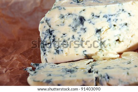 Roquefort cheese ,focus on a foreground. - stock photo