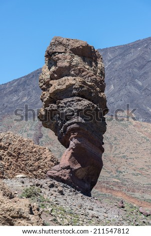 Roques de Garcia, with volcano in the background, in Teide National Park, Tenerife, Canary Islands, Spain - stock photo
