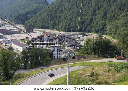"ROSA KHUTOR, RUSSIA - AUGUST 11, 2014: Railway station ""Rosa Khutor"" ski resort ""Alpika Service"". The view from the top. - stock photo"