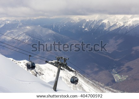 ROSA KHUTOR, RUSSIA - MARCH 31, 2016: Scenery mountain top view from Rosa Peak and cable ski elevator