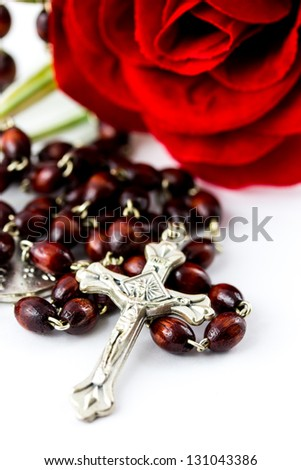 Rosary and rose on a white background - stock photo