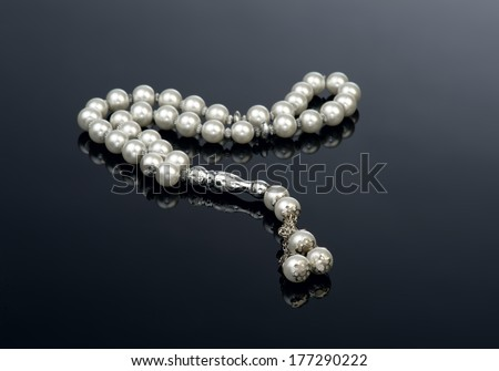 Rosary Isolated on black reflective background  - stock photo