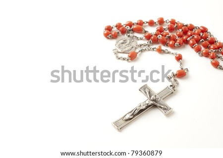 Rosary isolated over white background - stock photo
