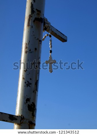 Rosary left with confidence on the top Krizevac close Mdjugorje in Bosnia and Herzegovina - stock photo