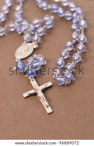 Rosary on Bible Cover - stock photo