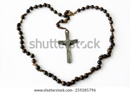 Rosary on the white background - stock photo