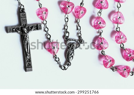 Rosary on the white background. - stock photo