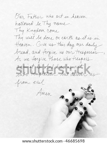 rosary with Lord's prayer - stock photo