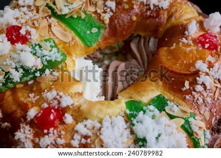 Roscón de reyes filled with truffle and cream. Spanish traditional pastry to eat in January. Filled kings roll - stock photo
