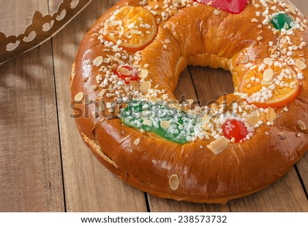 "Roscon de reyes (Three kings cake). It is a traditional Spanish holiday dessert served the morning of ""Reyes"" (King'??s Day), or Epiphany (January 6th) - stock photo"