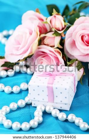 Rose  and gift  on blue cloth