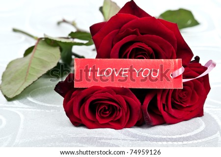 Rose bouquet and love you message - stock photo
