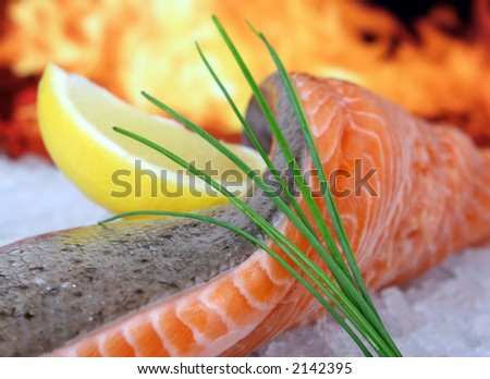 Rose colored fish steak, summer food with wine and lemon marinade macro closeup - stock photo