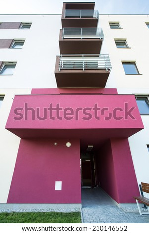 Rose entry to newly renovated apartment building - stock photo
