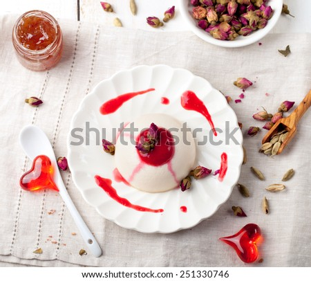 Rose flavor panna cotta, with berry sauce. Traditional Italian dessert. Valentines Day background - stock photo