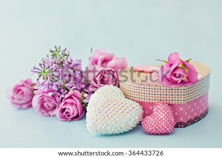 Rose flowers, gift box and two crystals heart for a Valentine's Day or wedding day . - stock photo