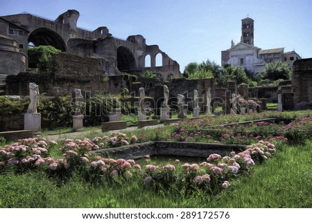 Rose Garden Surrounded by Statues at the Roman Forum in Rome, Italy