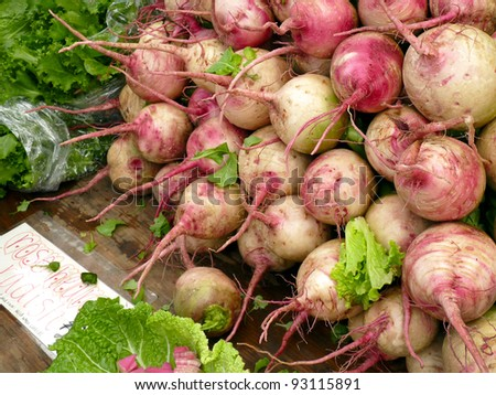Rose heart radishes at farmers' market - stock photo