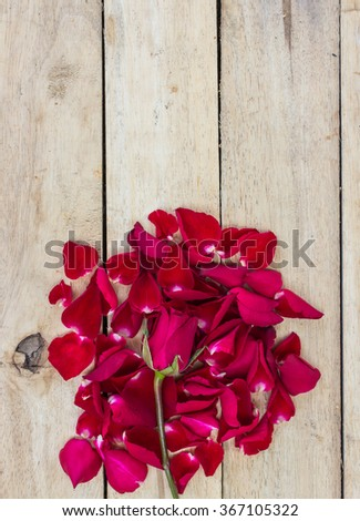 Rose Petals Border on a wooden table - stock photo