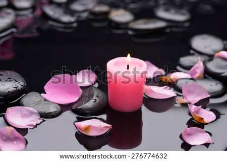 rose petals,candle and wet stones - stock photo