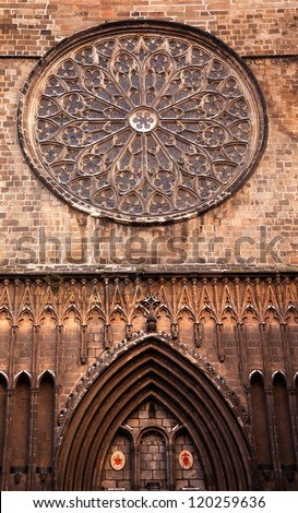 Rose Stained Glass Window, Old Stone Basilica, St Maria del Pi, Saint Mary of Pine Tree, in Barcelona, Spain. Founded in 987AD or earlier. One of the largest rose windows in the World created in 1380. - stock photo