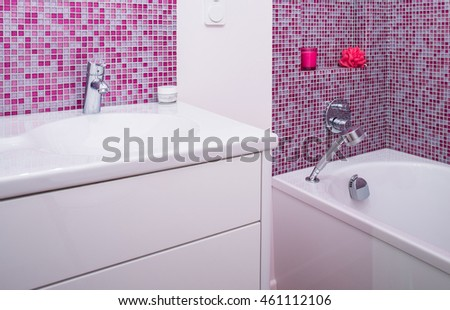 Rose tiles on the wall in modern bathroom