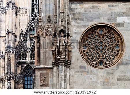 Rose window, maiden statue and other details of the famous cathedral of saint Stephan, Vienna, Austria - stock photo