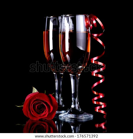 Rose with glasses and a red tape Alcohol and flower. Glasses with drink and a red rose. - stock photo