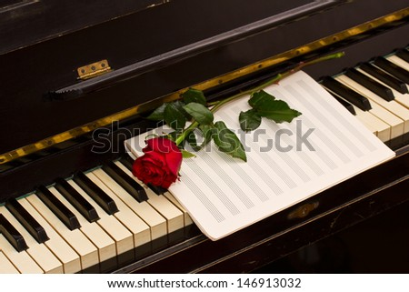 rose with notes paper on vintage piano - stock photo