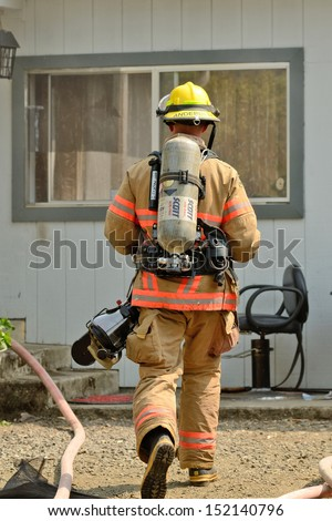 ROSEBURG, OR - JULY 31, 2013: Firefighters respond to a structure fire in a residence that caused major interior damage.  No body was injured in the Roseburg, Oregon incident on July 13, 2013