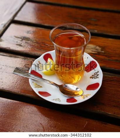 rosehip  turkish tea with slice lemon - stock photo