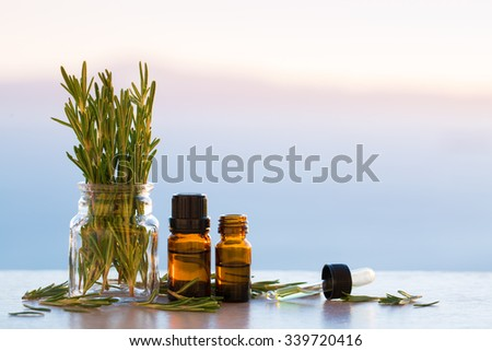 Rosemary aromatherapy essential oils in bottles - stock photo