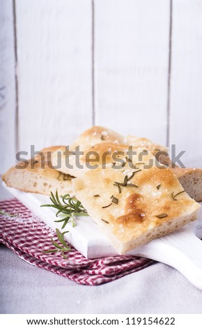 Rosemary Focaccia cut into pieces - stock photo