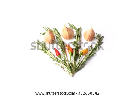 Rosemary garlic chilli peppers isolated on a white background - stock photo
