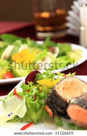 Rosemary roasted salmon served with asparagus - stock photo