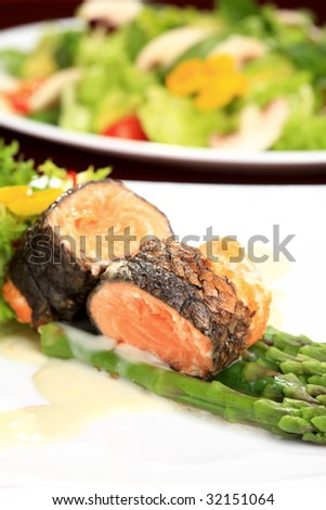 Rosemary roasted salmon served with asparagus