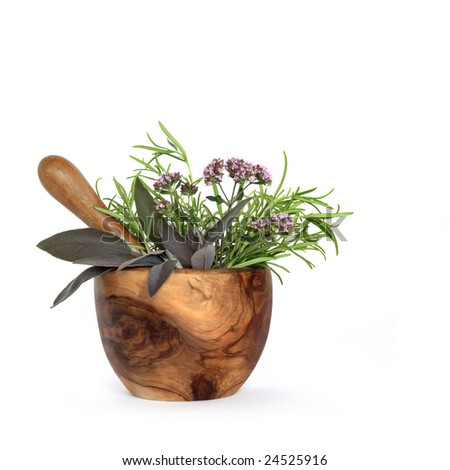 Rosemary, sage and marjoram herb leaves and flowers and an olive wood pestle and mortar, over white background.