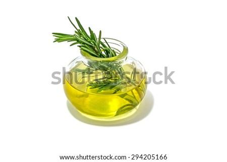 Rosemary with essential oil in a glass jar. - stock photo