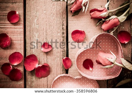 Roses and a hearts on wooden board, Valentines Day background Vintage Style. - stock photo