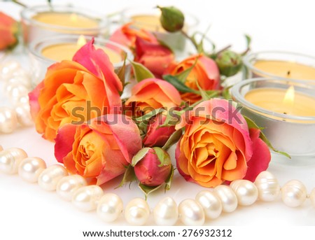 Roses and candles - stock photo