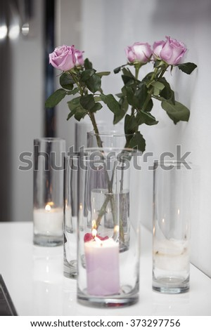 Roses and candles in vases