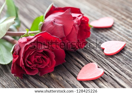 roses and hearts on wood - stock photo
