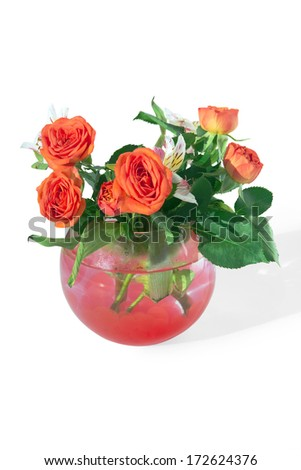 Roses and tiger lilies in a vase of red hydrogel balls (Super Absorbent Polymers)  - stock photo