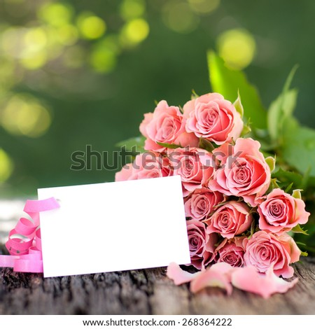 Roses and white paper - stock photo