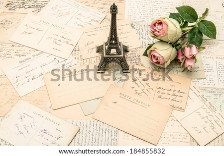 roses, antique french postcards and souvenir Eiffel Tower from Paris. nostalgic romantic background