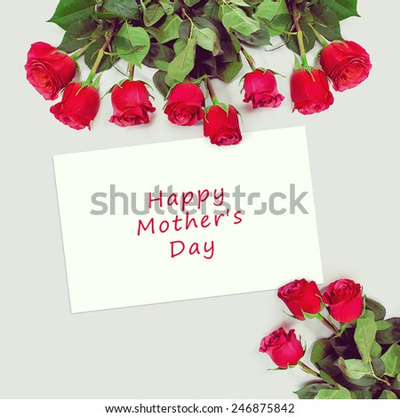 Roses bouquet and greeting card with sample text. Happy Mothers Day. - stock photo