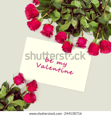 Roses bouquet and greeting card with sample text. Happy Valentines Day. - stock photo