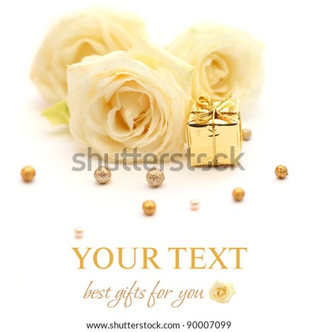 Roses, gift and golden beads on white