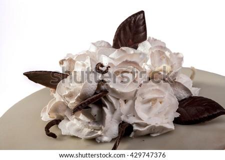 Roses on cake isolated on white background - stock photo
